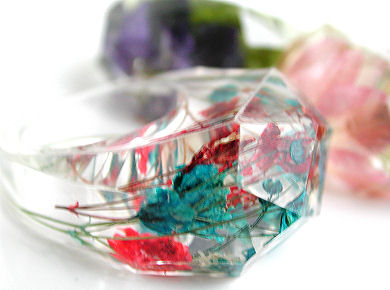clear resin ring with dried flowers